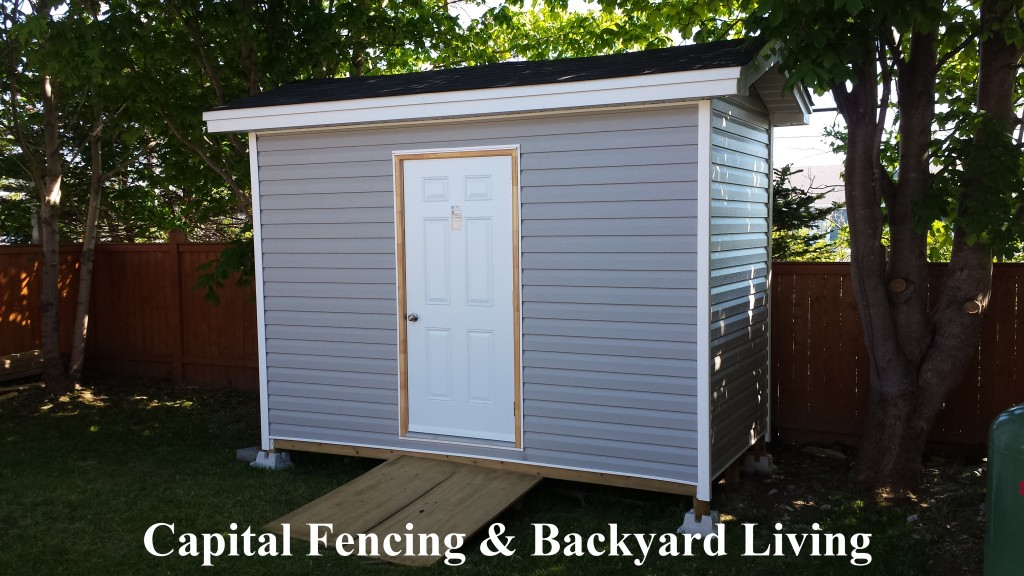 6x12 Shed with a ramp, steel door and white trim.