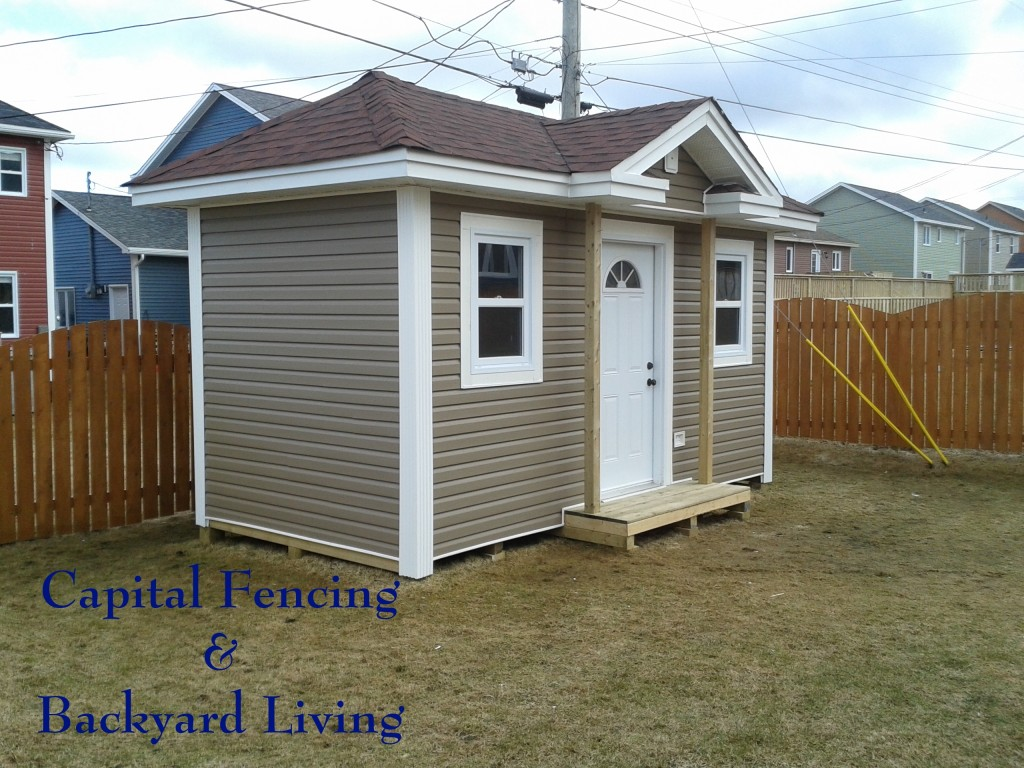 8X16 Shed built to match the owner's house. This Shed has1 Steel Door, 2 Windows, White Trim, and a small landing added on.